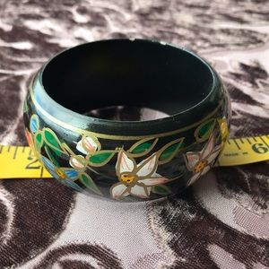 Black bangle with hand painted flowers.